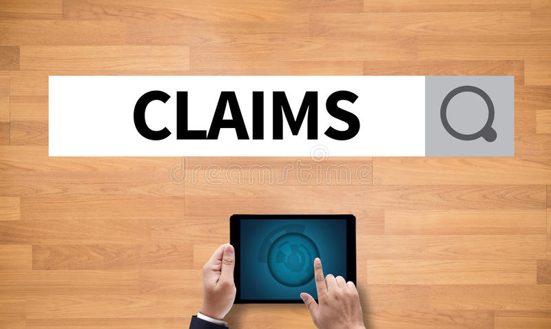 CLAIMS. On the tablet pc screen held by businessman hands - online, top view stock photos