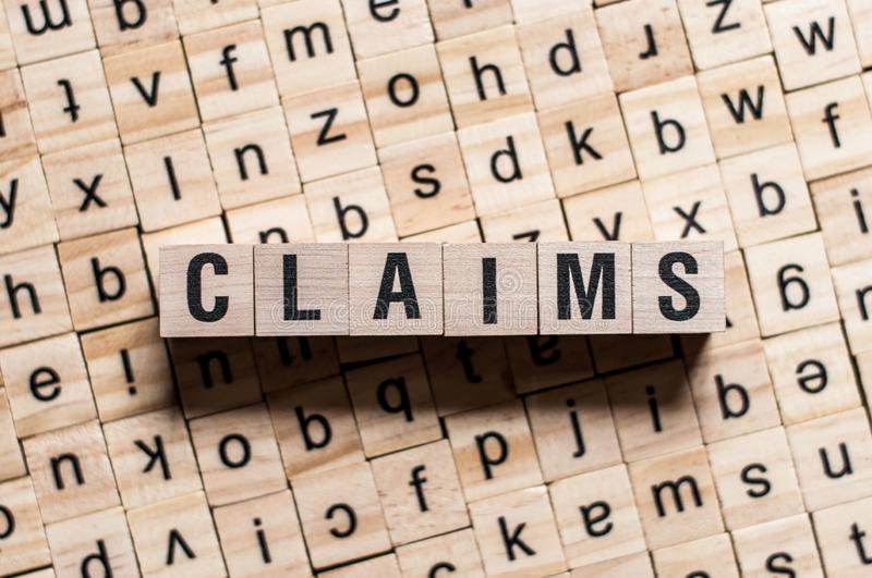 Claims word on wooden cubes royalty free stock image
