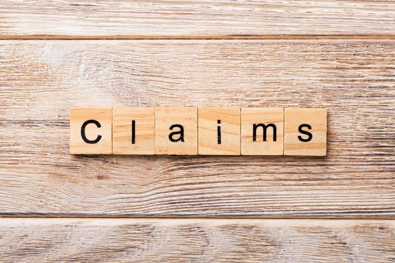 Claims word written on wood block. claims text on wooden table for your desing, concept.  stock images