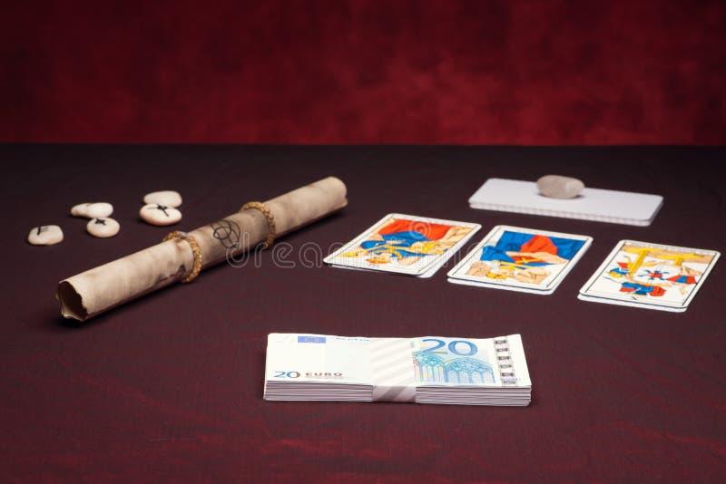 Clairvoyance equipment with money. On dark desk stock photo