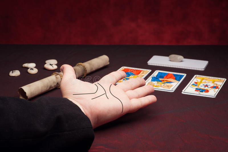 Clairvoyance equipment with palm. On dark desk royalty free stock photography