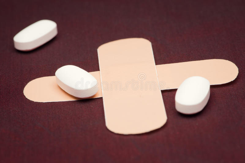 Clairvoyance equipment with pills. On dark desk royalty free stock images