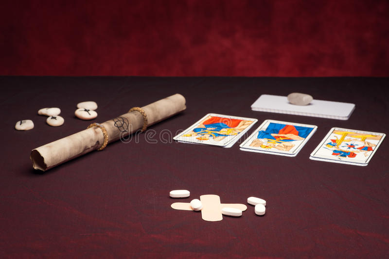 Clairvoyance equipment with pills. On dark desk stock photography