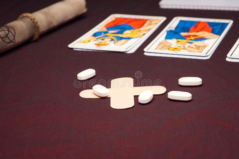 Clairvoyance equipment with pills. On dark desk stock images