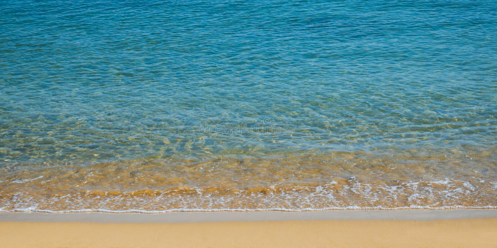 Clam and beautiful empty beach - amazing blue clear sea water and orange sand stock photo