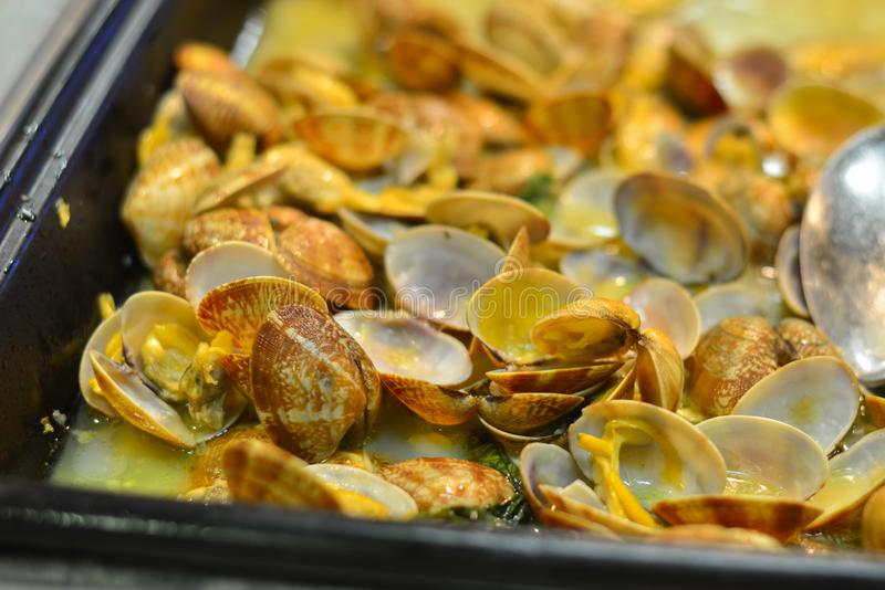 Clam with hot sauce. At buffet restaurant. Food concept royalty free stock photography