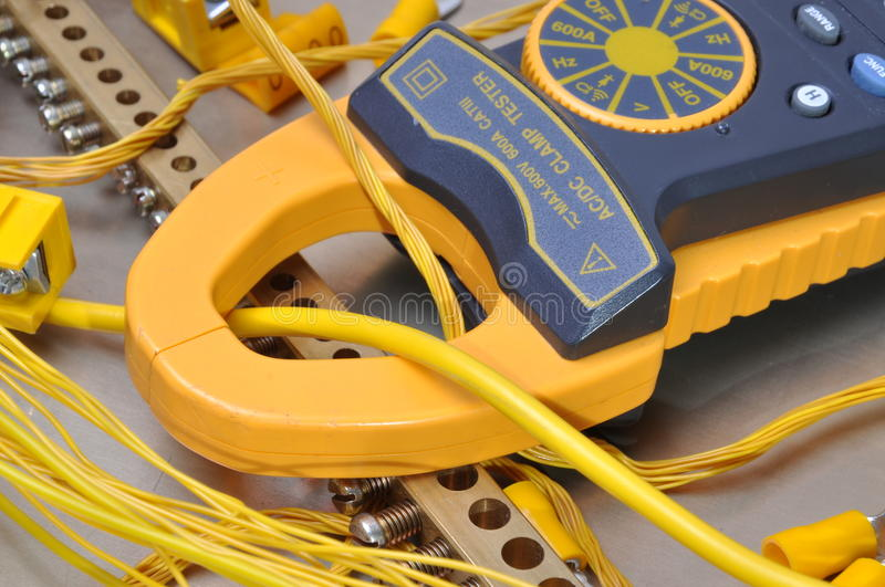Clamp meter tool for measuring electrical installations stock photo