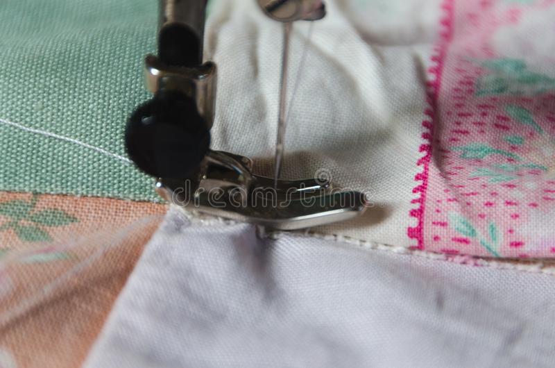 Clamp, and a needle and thread sewing machine stock photo