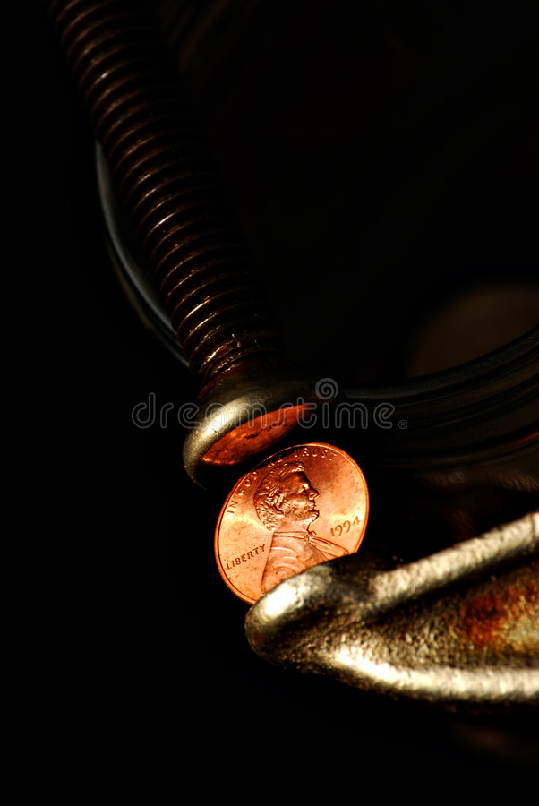 Clamp with penny royalty free stock photo