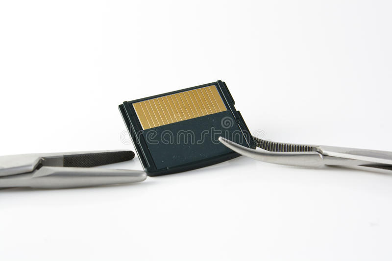 Clamps and memory card royalty free stock photo