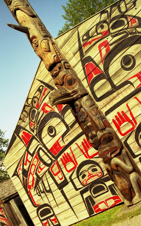 Clan House and Totem Pole stock photography
