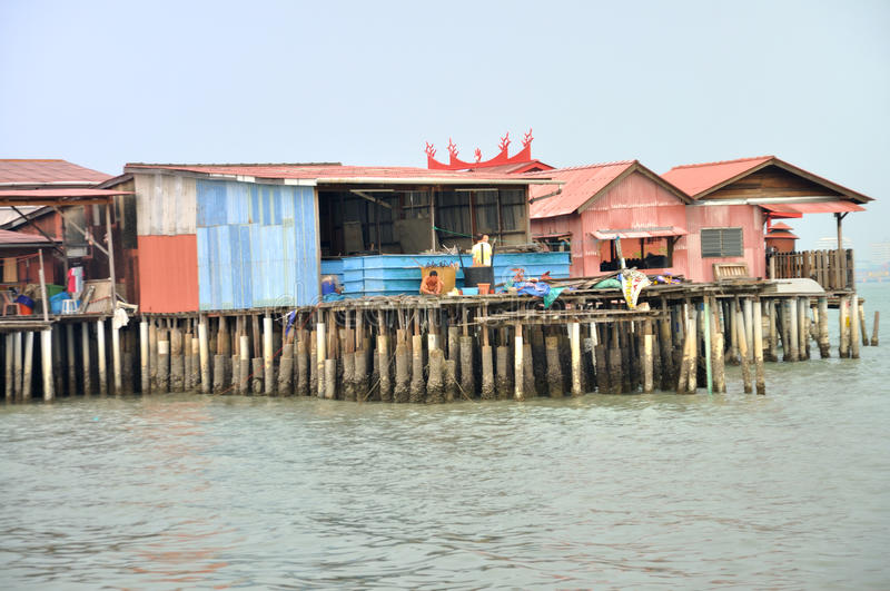 Clan Jetties of Penang. The Clan Jetties are unique Chinese settlements that have been around since the 19th century. Along the wooden pier are villages on royalty free stock photography