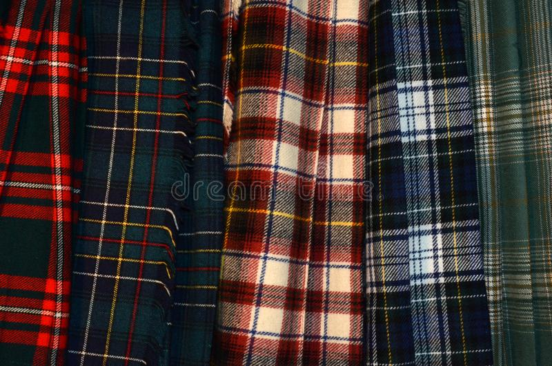 Clan tartan or plaid kilts in assorted colors stock image