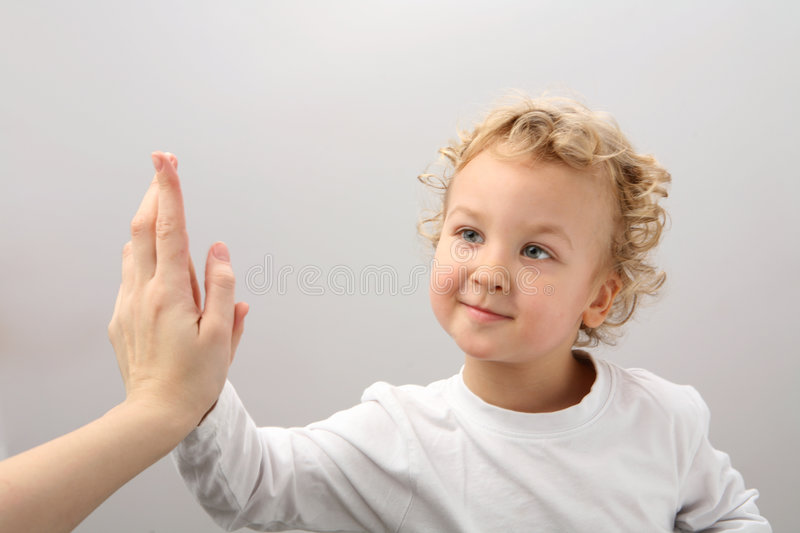 Clap hands. Child and adult clap hands royalty free stock image