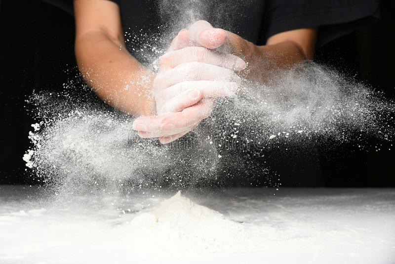 Clap hands of baker with flour stock image