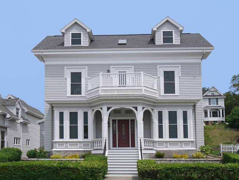 Clapboard house. New England style clapboard house with large porch royalty free stock image