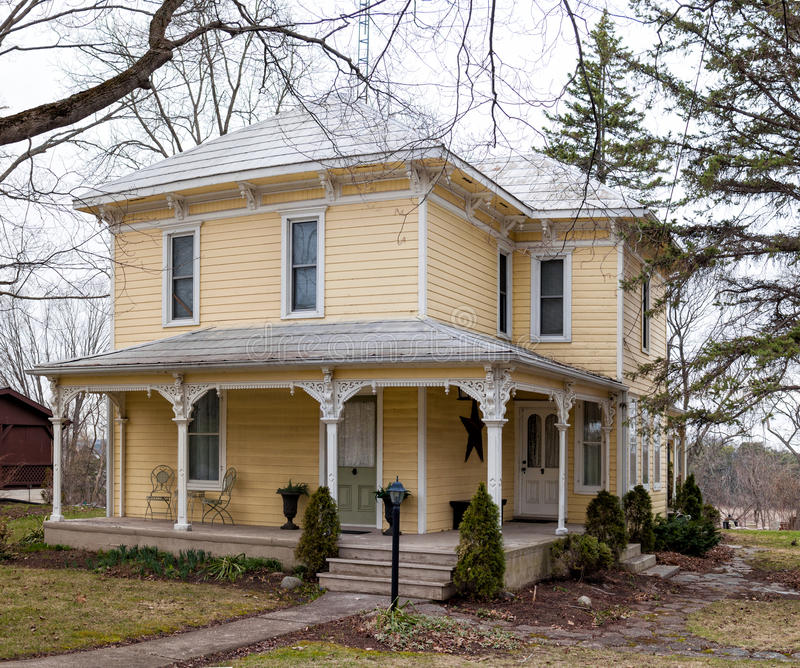 Clapboard house with a porch. Clapboard house with a covered porch royalty free stock photo