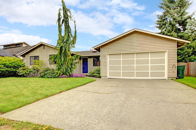 Clapboard siding house with garage. View of clapboard siding house with attached garage and concrete floor driveway stock photography