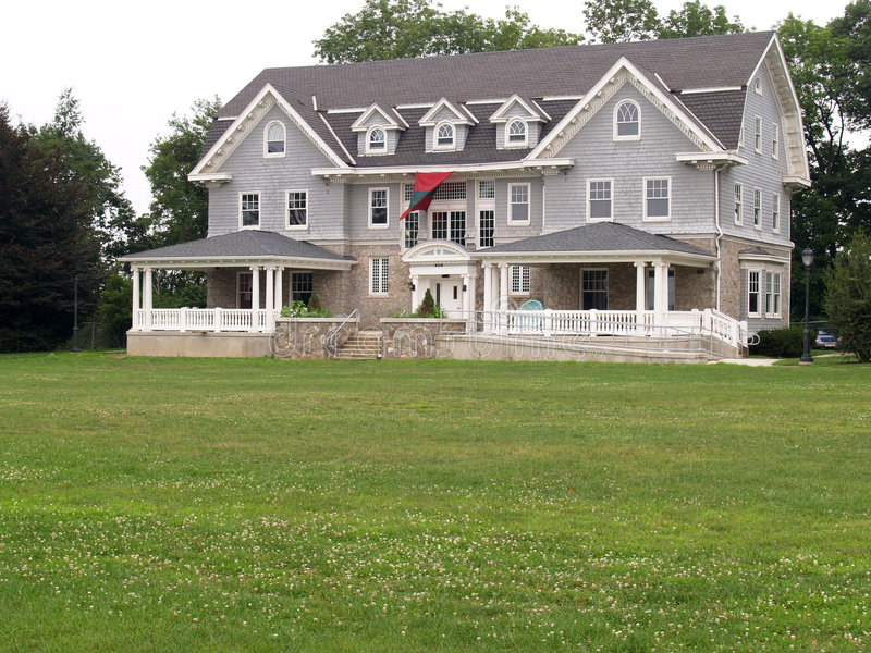 Clapboard style house. Gray clapboard style house with large front porches stock photos
