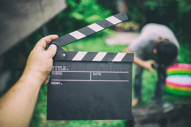 Clapper board,Movie clapper in hand and make movie background bl royalty free stock photos