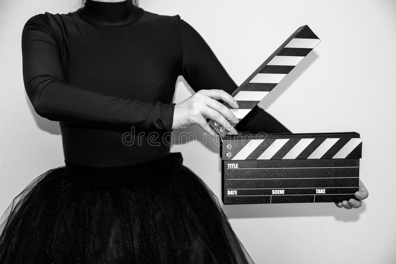 Clapperboard in hands stock images