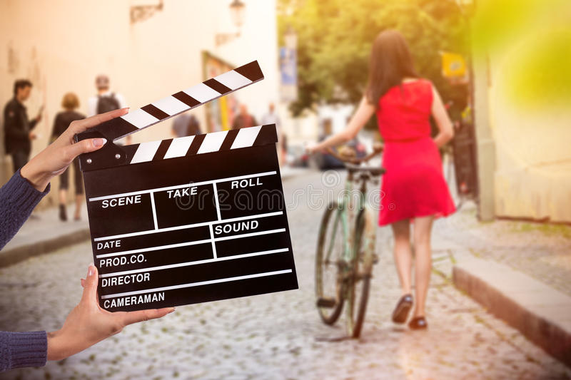 Clapperboard sign hold by female hands. Clapperboard sign hold by female hands, close-up stock photo