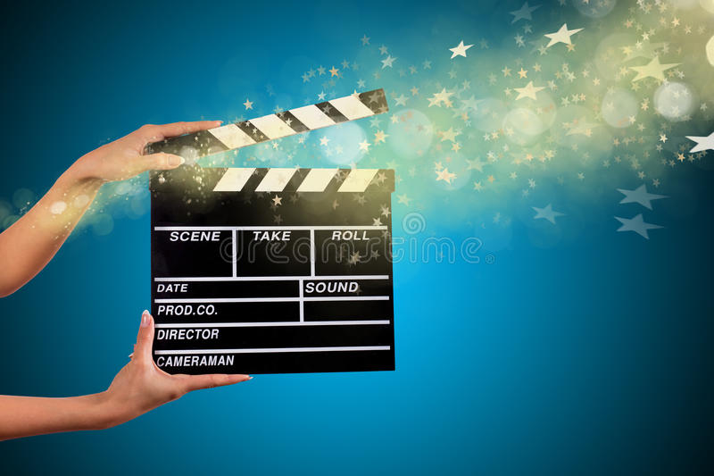 Clapperboard sign hold by female hands. Clapperboard sign hold by female hands, close-up stock images