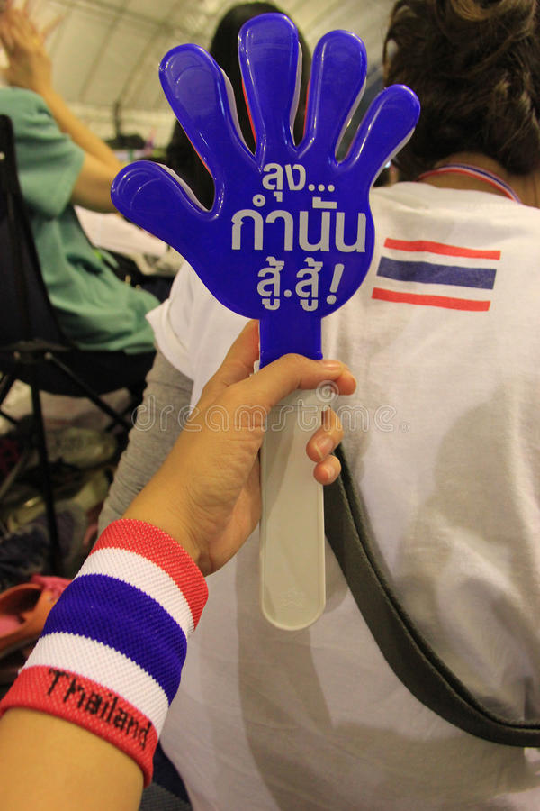 Clapping Hands. Bangkok, Thailand - January 26, 2014: Clapping hands are tools for protesters to use to support what the leaders say on the stage stock photo