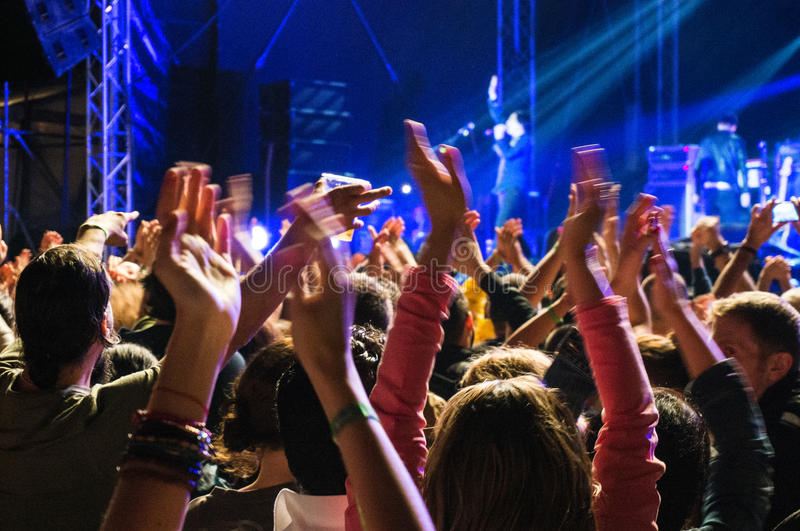 Clapping hands at concert. People clapping hands and singing at Texas band concert during Best Fest festival, Romania royalty free stock photos