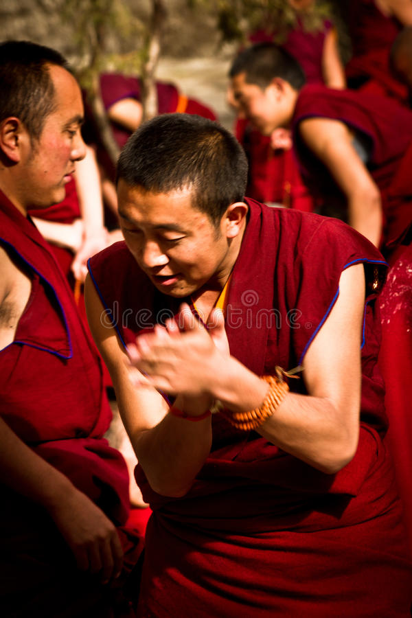 A clapping monk of Sera Monastery, Lhasa, Tibet. Sera Monastery Debating Monks, Lhasa, Tibet, a monk claps stock photography