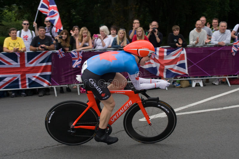 Clara Hughes in the Olympic Time Trial. Canadian Cyclist Clara Hughes on the road in Surrey during the London 2012 Olympic Cycling Time Trial stock photos