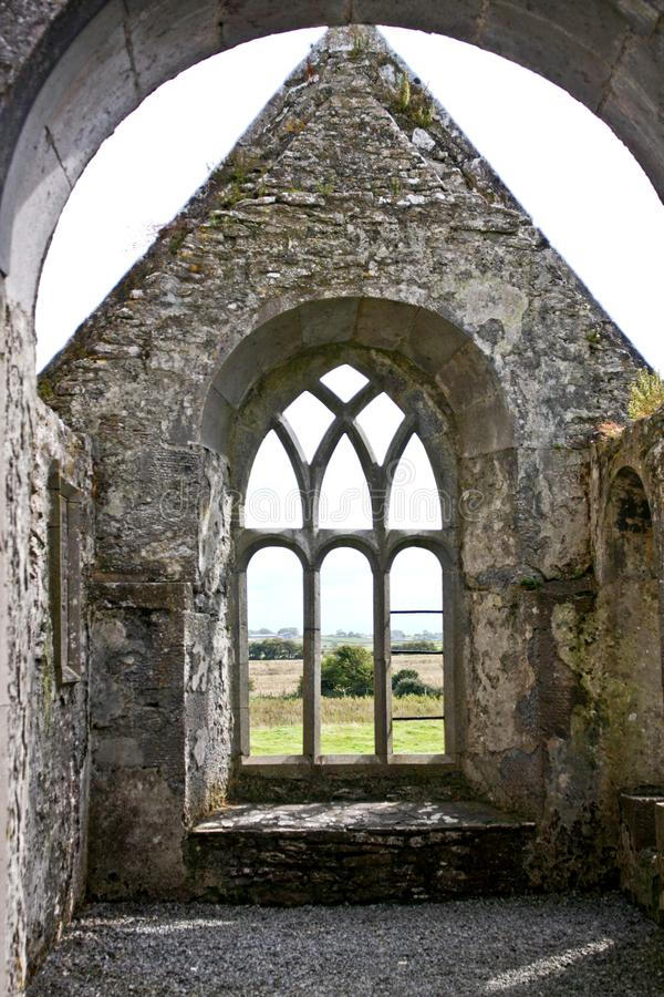 Ruins of Claregalway Friary, traceried windows, west of Ireland. The Claregalway Friary is a medieval Franciscan abbey located in the town of Claregalway, County stock images