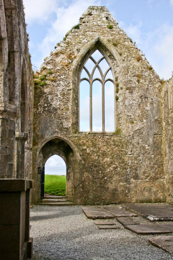 Ruins of Claregalway Friary, traceried windows, west of Ireland. The Claregalway Friary is a medieval Franciscan abbey located in the town of Claregalway, County stock photo