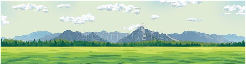 Clareira verde na perspectiva das montanhas imagem de stock