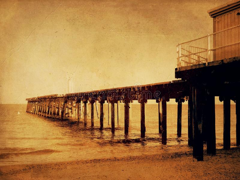 Claremont Pier from Lowestoft beach Suffolk in the evening. Claremont Pier in the evening from Lowestoft beach Suffolk United Kingdom sepia old film filter stock photo