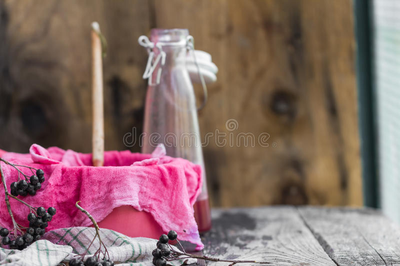 Clarification tincture chokeberry through fabric gases. Clarification tincture of chokeberry through the fabric of gases royalty free stock photography