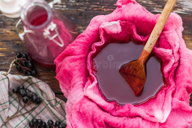 Clarification tincture chokeberry through fabric gases royalty free stock image