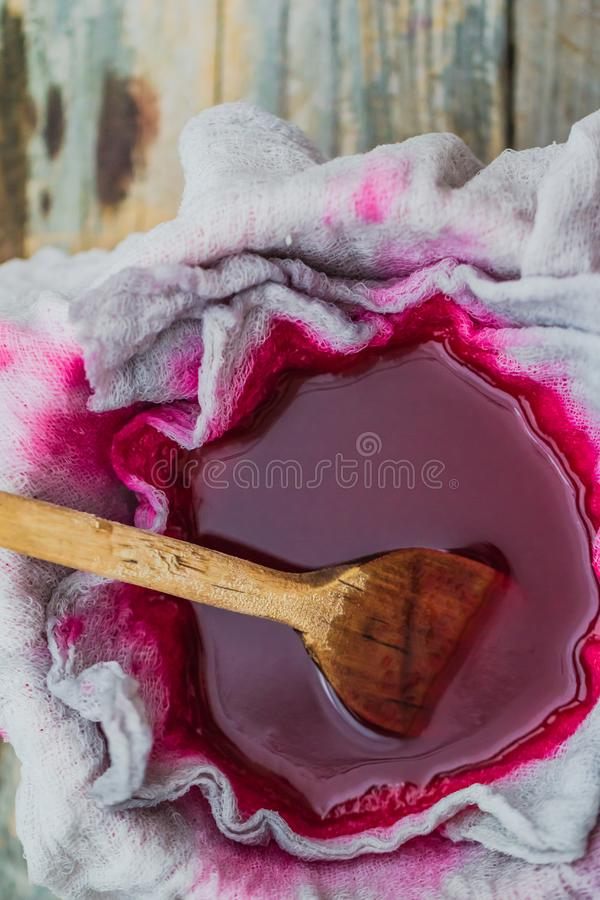 Clarification tincture chokeberry through fabric gases. Clarification tincture of chokeberry through the fabric of gases stock image