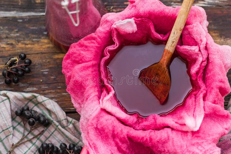 Clarification tincture chokeberry through fabric gases stock photos