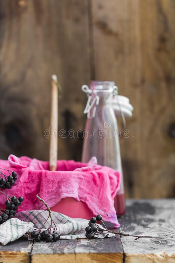 Clarification tincture chokeberry through fabric gases royalty free stock photo