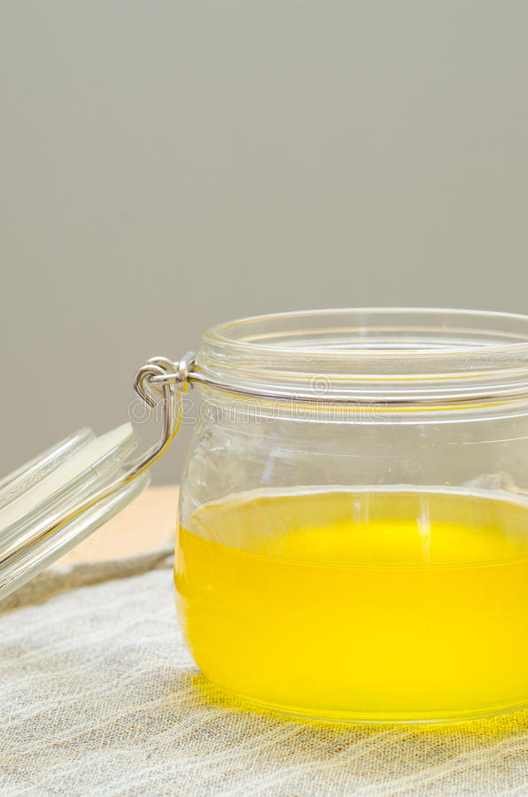 Clarified butter. Melted clarified butter in a jar stock images