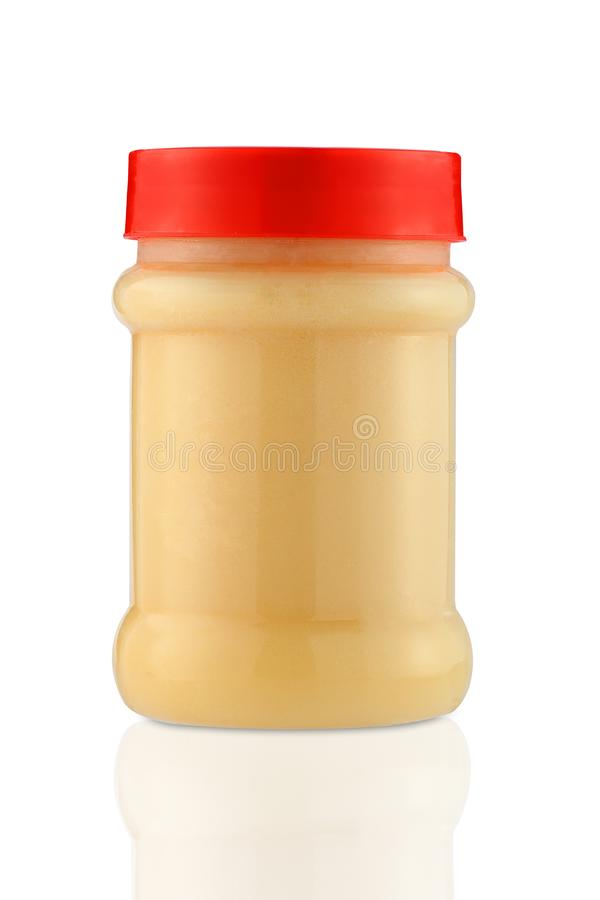 Clarified butter ghee ,. Clarified butter ghee in plastic jar royalty free stock photos