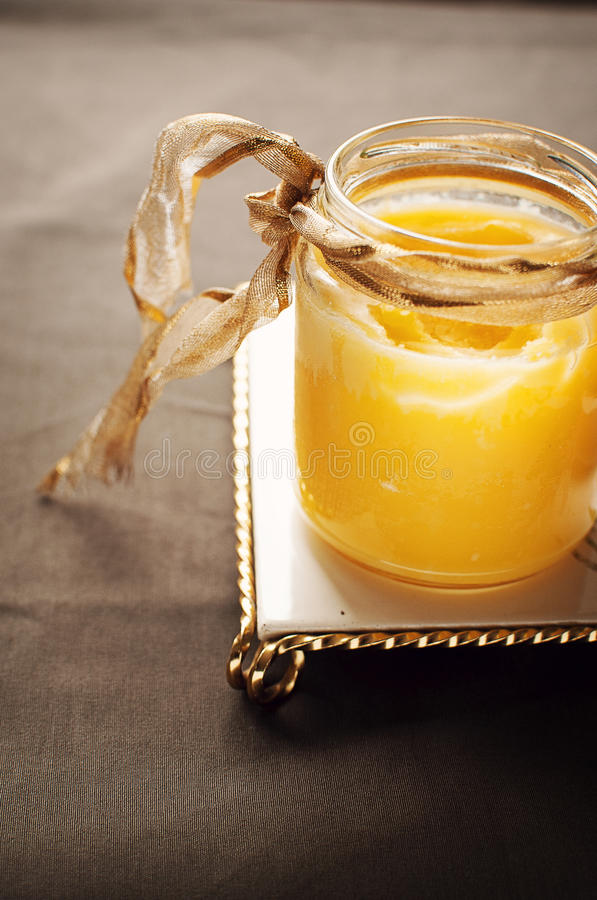 Clarified butter in jar. With ribbon royalty free stock image