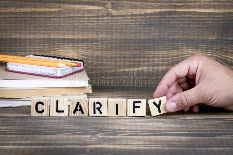 Clarify. Wooden letters on the office desk. Informative and communication background royalty free stock image