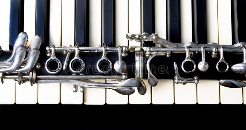 Clarinet and Keyboard. Closeup of a clarinet and keyboard royalty free stock image