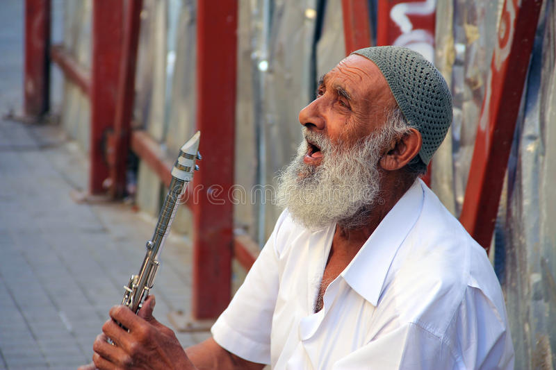Clarinet player. Istiklal, Turkey - Amateur old man playing clarinet stock image