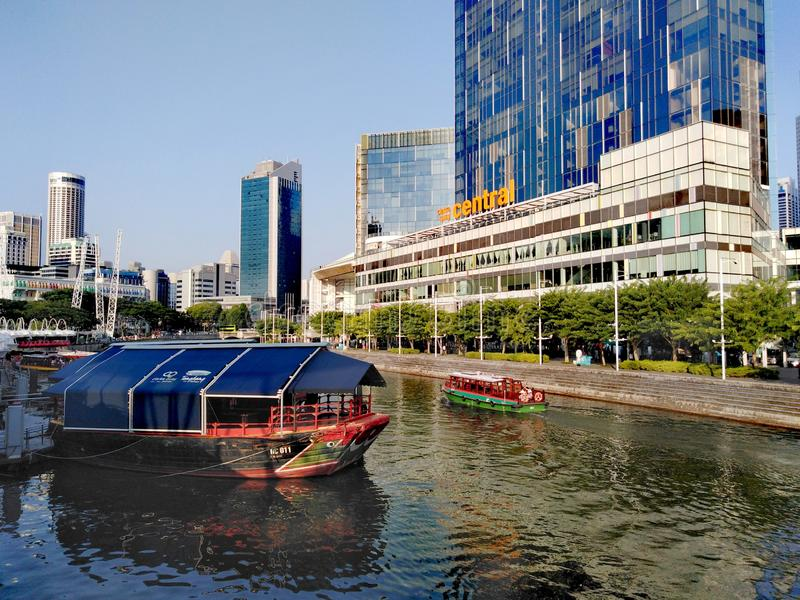 Clarke Quay at Singapore River. Bumboats ferrying tourists along Singapore River in Clarke Quay, Singapore City stock image
