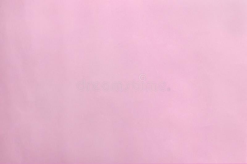 Claro - o rosa cor-de-rosa do backgroundight do papel, aumentou fundo textured do papel do ofício da cor imagens de stock royalty free