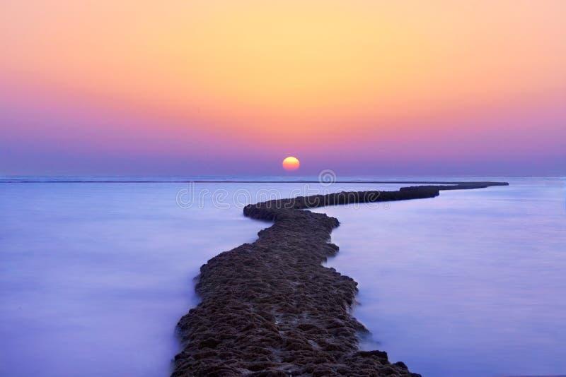 Clase social en la puesta del sol foto de archivo libre de regalías
