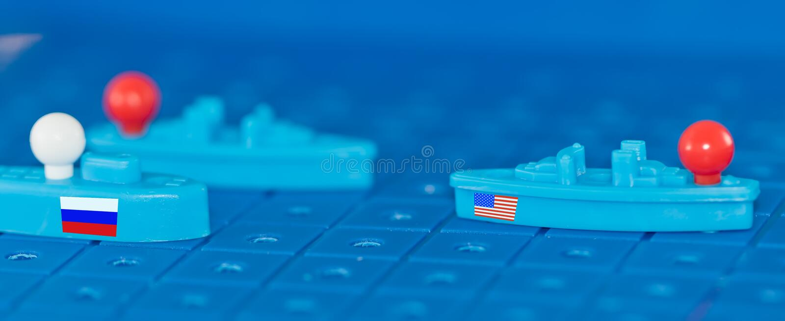 Clash of the toy battleship Board a Russian submarine and an American warship. With missiles stock image